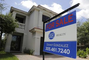 Photo - This Monday, May 19, 2014 photo shows a duplex home for sale in the Coconut Grove neighborhood in Miami. The National Association of Realtors reports on existing-home sales in April on Thursday, May 22, 2014. (AP Photo/Lynne Sladky)