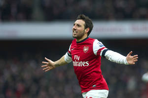 photo - Arsenal's Santi Cazorla reacts after scoring against Aston Villa, during their English Premier League soccer match, at the Emirates Stadium, in London, Saturday, Feb. 23, 2013. (AP Photo/Bogdan Maran)