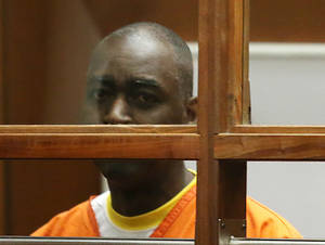Actor Michael Jace, center, appears in Los Angeles Superior Court for a preliminary hearing of the charge that he murdered his wife, Friday, Aug. 1, 2014. Jace waived his right to a preliminary hearing, which means the case will proceed to trial without an initial presentation of evidence to a judge. Jace played a police officer on The Shield TV series, appeared in the show Southland and had small roles in such movies as Boogie Nights and Forrest Gump. (AP Photo/Frederick Brown, Pool)