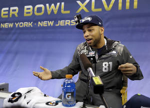 Photo - Seattle Seahawks' Golden Tate answers a question during media day for the NFL Super Bowl XLVIII football game Tuesday, Jan. 28, 2014, in Newark, N.J. (AP Photo/Jeff Roberson)