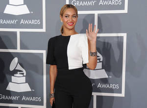 Photo - FILE - This Feb. 10, 2013 file photo shows Beyonce at the 55th annual Grammy Awards in Los Angeles. Beyonce's fifth self-titled album, released in surprise form late last week, is collection of songs that highlight Beyonce's evolution as a woman and artist.  (Photo by Jordan Strauss/Invision/AP, File)