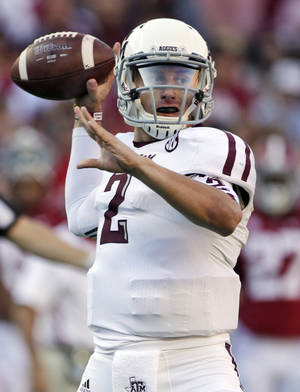 photo - FILE - In this Nov. 10, 2012, file photo, Texas A&amp;M quarterback Johnny Manziel (2) looks for a receiver during the first half of an NCAA college football game against Alabama at Bryant-Denny Stadium in Tuscaloosa, Ala. Manziel was selected to the first-team on The Associated Press All-America football team released Tuesday, Dec. 11, 2012.(AP Photo/Dave Martin, File)