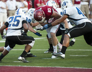 Photo - Indiana's Ted Bolser charges to the end zone against Indiana State defenders during an NCAA college football game Thursday, Aug. 29, 2013 in Bloomington, Ind.  (AP Photo/The Herald-Times, David Snodgress)