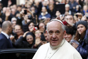 Photo - Pope Francis leaves Rome's Jesus' Church after celebrating a mass with the Jesuits, on the occasion of the order's titular feast, Friday, Jan. 3, 2014. (AP Photo/Riccardo De Luca)