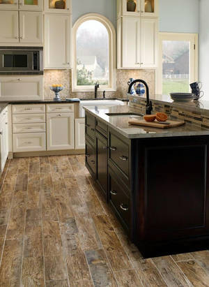 Photo - Porcelain wood tiles, which come in various shades from pecan and cherry to weathered tan, are durable, affordable and trending up.   PROVIDED BY FLOOR COVERINGS INTERNATIONAL <strong></strong>