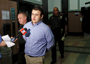 Photo - Tristan Owen, 17, leaves the courtroom Friday after being found guilty of two counts of manslaughter and one count of arson in an Oklahoma City. Photo by Bryan Terry, The Oklahoman