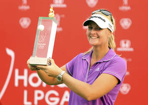 Photo - Anna Nordqvist of Sweden shows off her winner's trophy during the awarding ceremony of the LPGA Thailand golf tournament in Pattaya, southern Thailand, Sunday, Feb. 23, 2014.(AP Photo/Siamsport Newspaper) THAILAND OUT