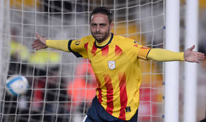 Photo - Catalonia's Sergio Garcia celebrates after scoring against Cape Verde during a friendly soccer match at Lluis Companys Stadium in Barcelona, Spain, Monday, Dec. 30, 2013. (AP Photo/Manu Fernandez)