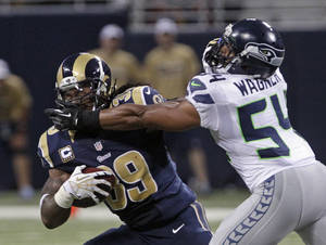 Photo -   St. Louis Rams running back Steven Jackson is tackled by Seattle Seahawks middle linebacker Bobby Wagner during the second half of an NFL football game Sunday, Sept. 30, 2012, in St. Louis. (AP Photo/Seth Perlman)
