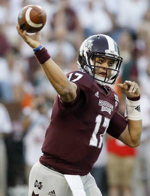 photo -   Mississippi State quarterback Tyler Russell (17) throws a first-quarter pass against South Alabama during their NCAA college football game in Starkville, Miss., Saturday, Sept. 22, 2012. (AP Photo/Rogelio V. Solis)