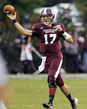 photo -   Mississippi State quarterback Tyler Russell (17) throws against Auburn in the first quarter of their NCAA college football game in Starkville, Miss., Saturday, Sept. 8, 2012. Mississippi State won 28-10. (AP Photo/Rogelio V. Solis)