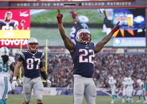 Photo - New England Patriots running back Stevan Ridley (22) celebrates his touchdown against the Miami Dolphins in the fourth quarter of an NFL football game Sunday, Oct. 27, 2013, in Foxborough, Mass. At left is Patriots tight end Rob Gronkowski. (AP Photo/Michael Dwyer)