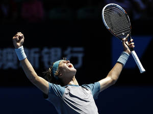 Photo - Alexander Zvere celebrates after winning the Australian Open boy's tennis championship against Stefan Kozlov of the U.S. in Melbourne, Australia, Saturday, Jan. 25, 2014. (AP Photo/Aijaz Rahi)