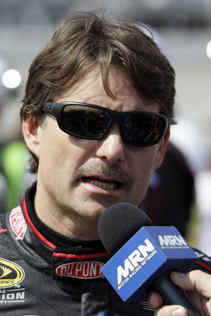 Photo -   Jeff Gordon talks to reporters before the NASCAR Sprint Cup Series auto race at Chicagoland Speedway in Joliet, Ill., Sunday, Sept. 16, 2012. (AP Photo/Nam Y. Huh)
