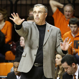 Photo - OSU: Oklahoma State coach Jim Littell signals to his team during a women's college basketball game between Oklahoma State University Cowgirls  and the Texas Tech Lady Raiders at Gallagher-Iba Arena in Stillwater, Okla., Wednesday, Feb. 8, 2012. Oklahoma State won 53-49. Photo by Bryan Terry, The Oklahoman