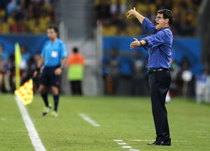 Photo - Russia's head coach Fabio Capello gives directions to his players from the sidelines during the group H World Cup soccer match between Russia and South Korea at the Arena Pantanal in Cuiaba, Brazil, Tuesday, June 17, 2014.  (AP Photo/Ivan Sekretarev)