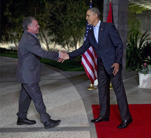 Photo - President Barack Obama, right, greets Jordan's King Abdullah II at The Annenberg Retreat at Sunnylands, Rancho Mirage, Calif., Friday, Feb. 14, 2014. (AP Photo/Jacquelyn Martin)