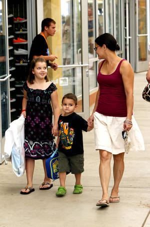 photo - LeAnn Keenan and children Alyson and Hayden at The Outlet Shoppes at Oklahoma City on the state tax-free weekend, held Aug. 3-5. Photo by STEVE SISNEY,  THE OKLAHOMAN