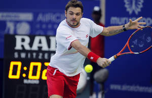 Photo - Stanislas Wawrinka of Switzerland plays a shot against France's Edouard Roger-Vasselin during their final match at the ATP Chennai Open tennis tournament in Chennai, India, Sunday, Jan. 5, 2014. (AP Photo/Arun Sankar K.)