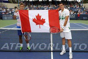 Photo - Vasek Pospisil, left, and Milos Raonic, right, both of Canada, pose before the men's singles final at the Citi Open tennis tournament, Sunday, Aug. 3, 2014, in Washington. Raonic won 6-1, 6-4. (AP Photo/Nick Wass)
