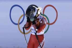 Photo - Switzerland's Lara Gut reacts after finishing the women's downhill at the Sochi 2014 Winter Olympics, Wednesday, Feb. 12, 2014, in Krasnaya Polyana, Russia. (AP Photo/Kirsty Wigglesworth)