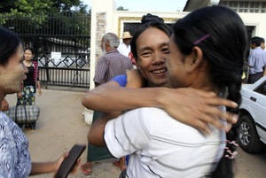 photo -   A Myanmar prisoner, center, is welcomed by her relative outside Insein prison in Yangon, Myanmar after the political prisoners were released Thursday, Nov. 15, 2012. Myanmar reformist government ordered more than 450 prisoners freed Thursday in an amnesty apparently intended as a goodwill gesture ahead of an historic visit by President Barack Obama next week. (AP Photo/Khin Maung Win)