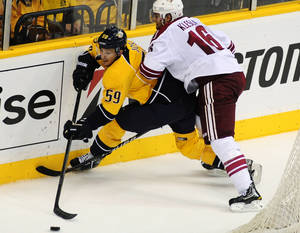 Photo -   Nashville Predators defenseman Roman Josi (59), of Switzerland, is checked by Phoenix Coyotes defenseman Rostislav Klesla (16), of the Czech Republic, in the second period of Game 4 in an NHL hockey Stanley Cup Western Conference semifinal playoff series, Friday, May 4, 2012, in Nashville, Tenn. (AP Photo/Mike Strasinger)