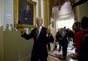 photo - Vice President Joe Biden gives two thumbs up following a Senate Democratic caucus meeting about the fiscal cliff on Capitol Hill on Monday, Dec. 31, 2012 in Washington. (AP Photo/Alex Brandon)
