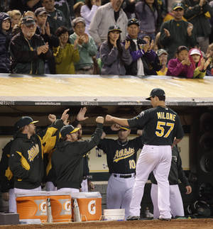 photo -   Oakland Athletics' Tommy Milone is congratulated after leaving in the seventh inning of a baseball game against the against the Baltimore Orioles Friday, Sept. 14, 2012, in Oakland, Calif. (AP Photo/Ben Margot)