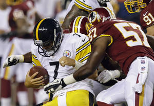 Photo - Pittsburgh Steelers quarterback Ben Roethlisberger (7) is hit by Washington Redskins linebackers London Fletcher (59), and Brandon Jenkins (57) during the first half of an NFL preseason football game Monday, Aug. 19, 2013, in Landover, Md. (AP Photo/Alex Brandon)