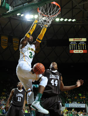 Photo -   Baylor's Cory Jefferson (34), left, scores over Lehigh's Conroy Baltimore (44), right and Mackey McKnight (11), left, in the first half of an NCAA college basketball game on Friday, Nov. 9, 2012, in Waco, Texas. (AP Photo/Waco Tribune Herald, Rod Aydelotte)
