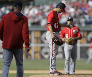 Photo - Washington Nationals pitcher Gio Gonzalez (47) reacts as manager Matt Williams, left, comes to the mound to replace him in the eighth inning of a baseball game against th Philadelphia Phillies, Sunday, May 4, 2014, in Philadelphia. (AP Photo/Laurence Kesterson)