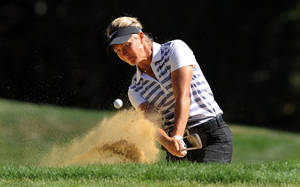 Photo - Suzann Pettersen, of Norway, hits a shot out of a bunker on the fifth hole during the final round of the LPGA Safeway Classic golf tournament in Portland, Ore., Sunday, Sept. 1, 2013. Pettersen shot a 5 under par 67 to win the tournament. (AP Photo/Steve Dykes)