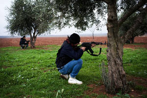 Photo - Free Syrian Army fighters aim their weapons, close to a military base, near Azaz, Syria, Monday, Dec. 10, 2012. The gains by rebel forces came as the European Union denounced the Syrian conflict, which activists say has killed more than 40,000 people. (AP Photo/Manu Brabo)