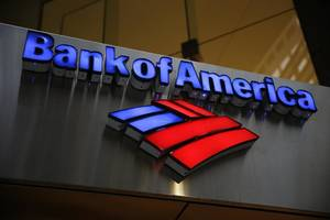 Photo - FILE - This Tuesday, Jan. 14, 2014 file photo shows a Bank of America sign in Philadelphia. Bank of America Corp. reports quarterly financial results on Wednesday, July 16, 2014. (AP Photo/Matt Rourke, File)