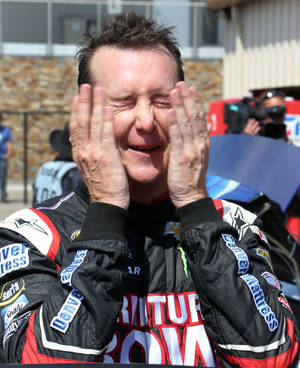 Photo - NASCAR Sprint Cup series driver Kurt Busch wipes his face after practice for the Pure Michigan 400 auto race at Michigan International Speedway in Brooklyn, Mich., Saturday, Aug. 17, 2013. (AP Photo/Bob Brodbeck)
