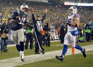 Photo - New England Patriots running back LeGarrette Blount (29) scores a touchdown past Buffalo Bills safety Jim Leonhard (35) in the second quarter of an NFL football game, Sunday, Dec. 29, 2013, in Foxborough, Mass. (AP Photo/Elise Amendola)