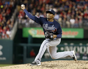 Photo - Atlanta Braves starting pitcher Julio Teheran throws during the fifth inning of a baseball game against the Washington Nationals at Nationals Park on Saturday, April 5, 2014, in Washington. The Braves won 6-2. (AP Photo/Alex Brandon)