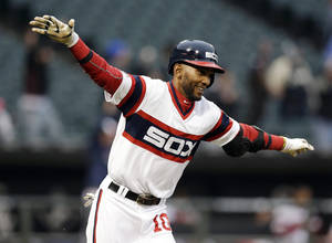 Photo - Chicago White Sox's Alexei Ramirez celebrates as he rounds the bases after hitting the game-winning two-run home run during the ninth inning of a baseball game against the Cleveland Indians in Chicago on Sunday, April 13, 2014. The White Sox won 4-3. (AP Photo/Nam Y. Huh)