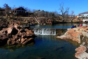 photo - Medicine Creek offers a scenic setting for fishing even if the trout don't bite. Medicine Creek in Medicine Park is Oklahoma's newest winter only trout fishery. Trout fishing will be available at Medicine Creek through mid-March. Photo by Donny Carter