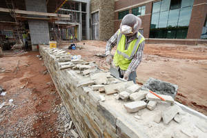 Photo - Natural native stones are being used throughout the new $88 million Mercy Edmond I-35 medical complex and wellness center. It is 60 percent complete. PHOTO BY PAUL HELLSTERN, THE OKLAHOMAN