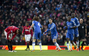 photo - Chelsea's Eden Hazard, centre, celebrates with teammates after scoring against Manchester United during their English FA Cup quarterfinal soccer match at Old Trafford Stadium, Manchester, England, Sunday March 10, 2013. (AP Photo/Jon Super)
