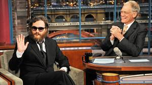 Photo - Actor Joaquin Phoenix, waves to the audience during his interview with Late Show host David Letterman during the Late Show with David Letterman Wednesday Feb. 11, 2008 on the CBS Television Network.