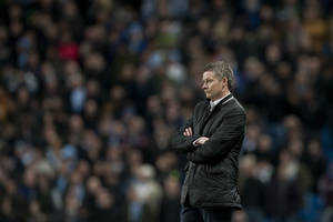 Photo - Cardiff City's manager Ole Gunnar Solskjaer watches his team's 4-2 loss against Manchester City in their English Premier League soccer match at the Etihad Stadium, Manchester, England, Saturday Jan. 18, 2014. (AP Photo/Jon Super)