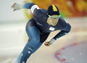 Photo - Australia's Daniel Greig skates during a test race at the Adler Arena Skating Center during the 2014 Winter Olympics in Sochi, Russia, Wednesday, Feb. 5, 2014. (AP Photo/Patrick Semansky)