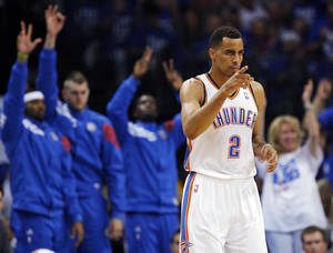 photo - Oklahoma City's Thabo Sefolosha (2) reacts after a 3-point shot during Game 4 of the Western Conference Finals between the Oklahoma City Thunder and the San Antonio Spurs in the NBA playoffs at the Chesapeake Energy Arena in Oklahoma City, Saturday, June 2, 2012.  Photo by Nate Billings, The Oklahoman