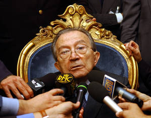 Photo - OBIT - In this photo fro files taken at the senate in Rome on Oct. 15 2004, Italian life senator Giulio Andreotti talks to journalists during a press conference. Italian state television says Giulio Andreotti, Italy's former seven-time premier, has died at age 94. At his prime, Andreotti was one of Italy's most powerful men: he helped draft the country's constitution after World War II, sat in parliament for 60 years and served as premier seven times. Andreotti was hospitalized last year with heart problems stemming from a respiratory infection. (AP Photo/Plinio Lepri)