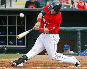 Photo - Oklahoma City's Preston Tucker (12) bats during the minor league baseball game between the Oklahoma City Redhawks and the Las Vegas 51s at the Chickasaw Bricktown Ballpark on Sunday, June 15,  2014.  Photo by KT King, The Oklahoman