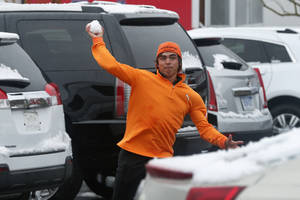 photo - Rickie Fowler throws snowballs at fellow players in the parking lot after a snow storm suspended the Match Play Championship golf tournament, Wednesday, Feb. 20, 2013, in Marana, Ariz. Play was suspended for the day. (AP Photo/Ross D. Franklin)