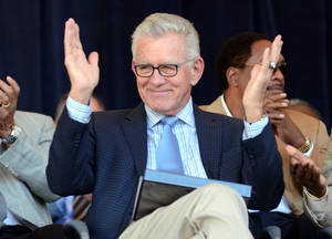 Photo - FILE - In this July 21, 2012, file photo, Tim McCarver greets the crowd before accepting the Ford C. Frick Award for excellence in baseball broadcasting as part of the Baseball Hall of Fame Induction ceremonies at Doubleday Field in Cooperstown, N.Y. McCarver says he will step down from his position at Fox after this season.  (AP Photo/Heather Ainsworth, File) ORG XMIT: NY154